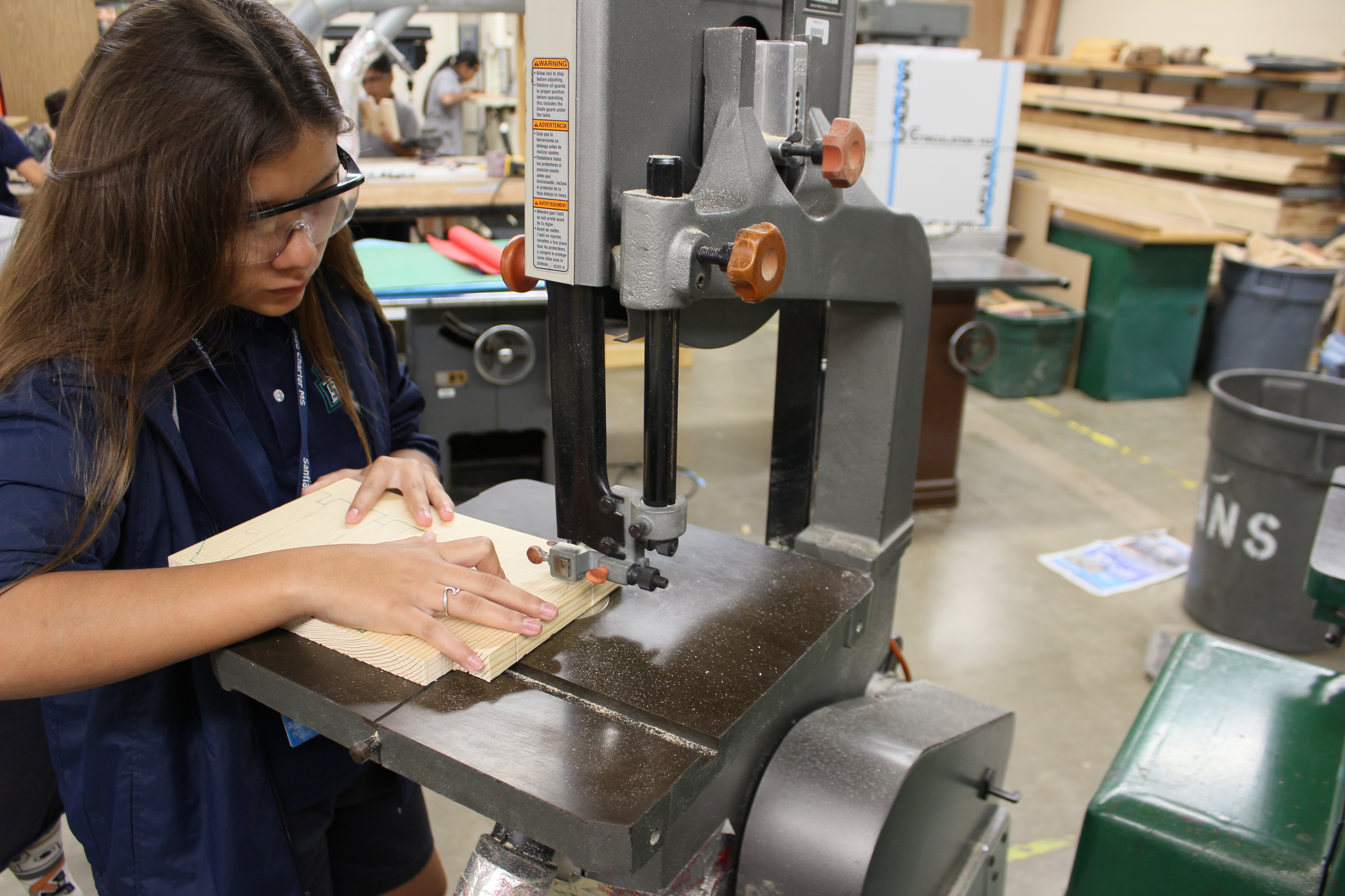 Student working at band saw