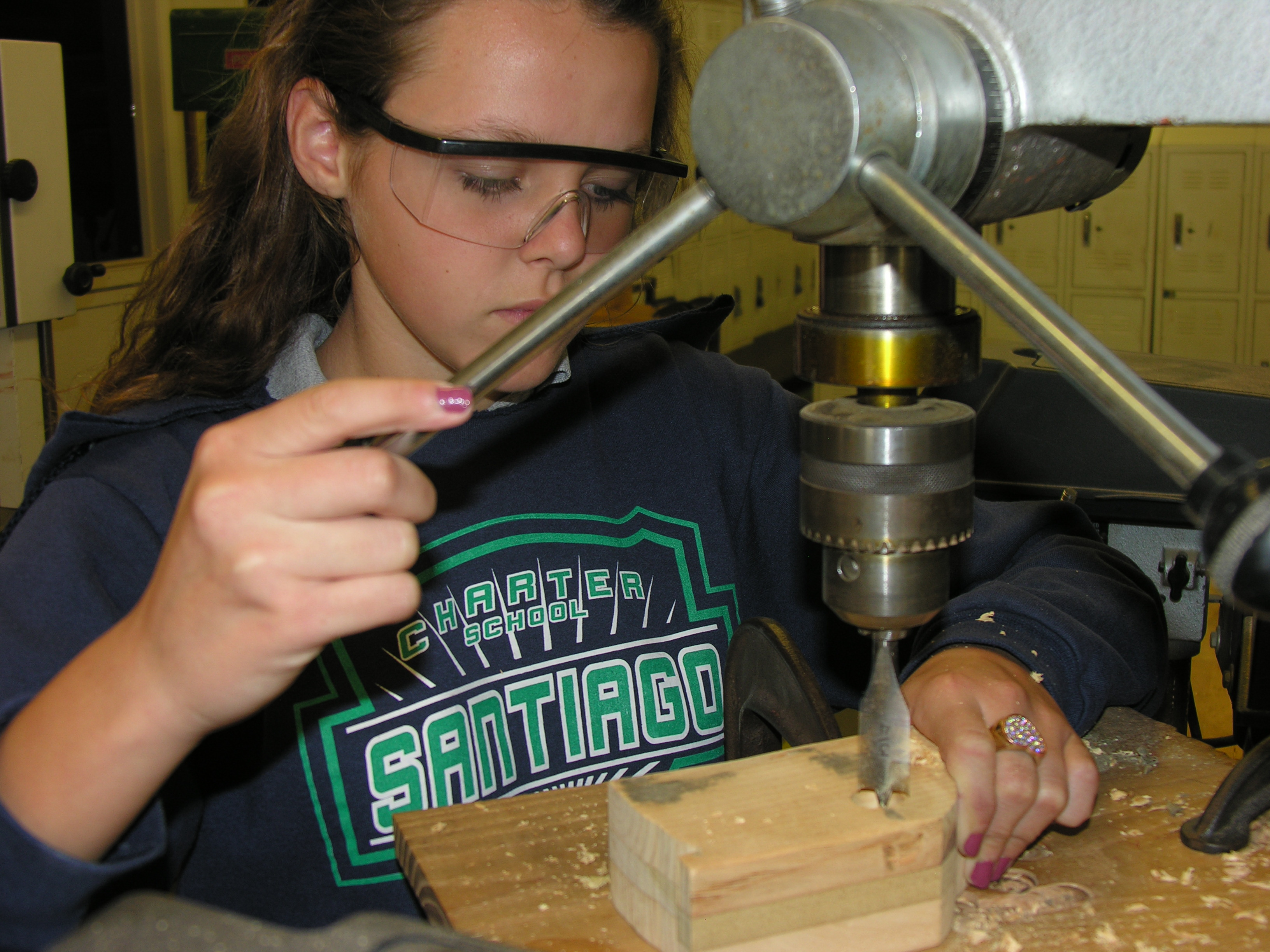 Student working at drill press